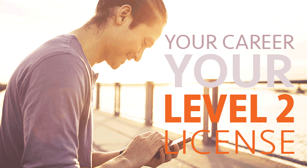 Man on dock looking down at phone smiling. Text: Your career your level 2 license