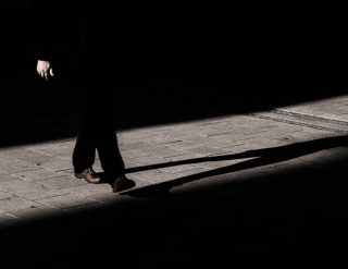A shadowy man walking in the shadows