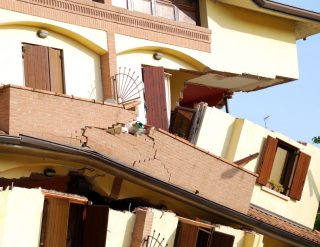 A Spanish colonial style building that has been badly damaged by an earthquake.